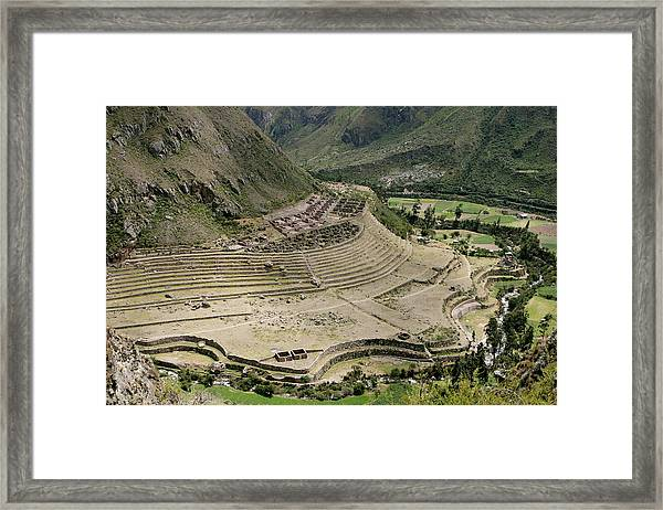 Nestled At The Foot Of A Mountain Framed Print