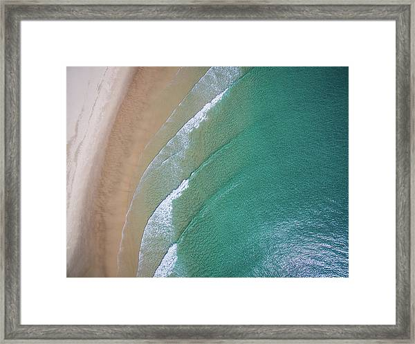 Ocean Waves Upon The Beach Framed Print