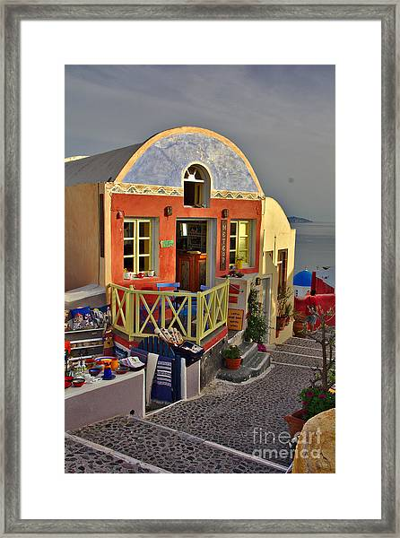 Framed Print featuring the photograph Oia Pub by Jeremy Hayden