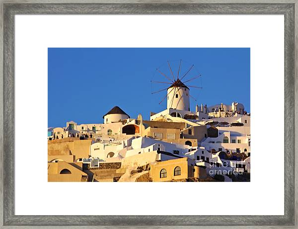 Framed Print featuring the photograph Oia Windmill by Jeremy Hayden