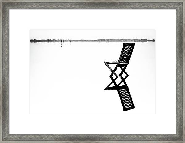 Old Chair In Calm Water Framed Print