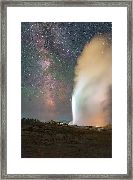 Old Faithful Erupts At Night Framed Print