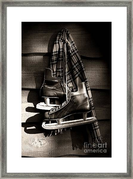 Old Hockey Skates With Scarf Hanging On A Wall Framed Print