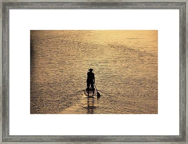 Old Man Paddling Into The Sunset Framed Print