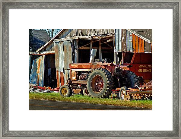 Old Red Tractor And The Barn Framed Print