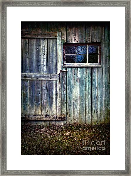 Old Shed Door With Spooky Shadow In Window Framed Print