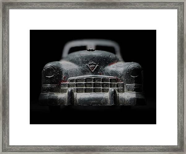 Old Silver Cadillac Toy Car With Specks Of Red Paint Framed Print