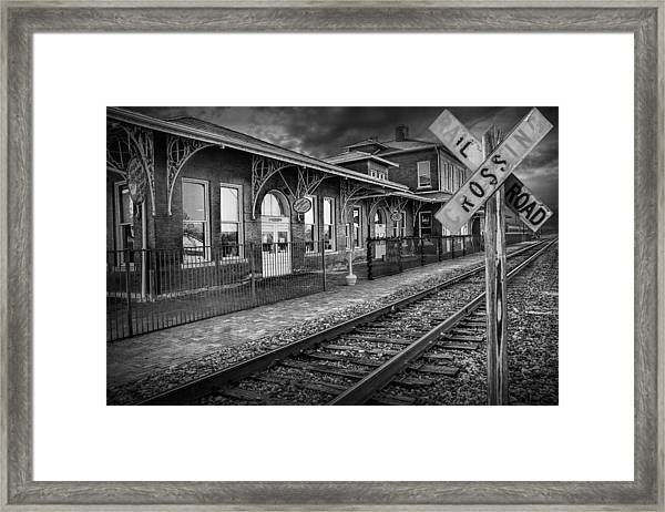 Old Train Station With Crossing Sign In Black And White Framed Print