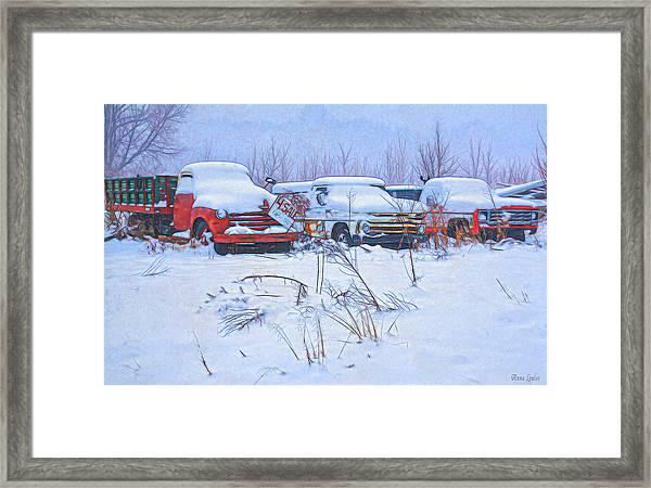 Old Trucks In Snow Framed Print