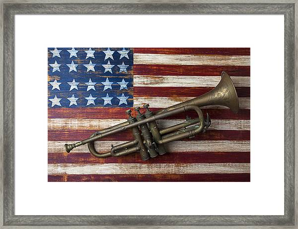 Old Trumpet On American Flag Framed Print