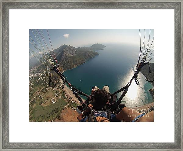 Framed Print featuring the photograph Paragliding Fly Above Laguna Seascape by Raimond Klavins