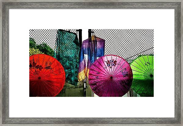 Parasols At A Flea Market Framed Print