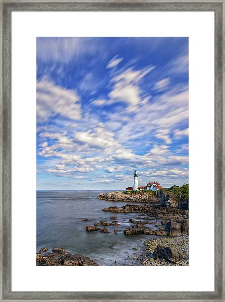 Passing Clouds At Portland Head Light Framed Print