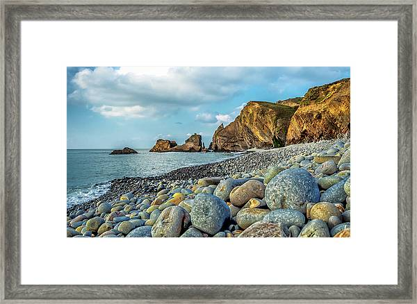 Framed Print featuring the photograph Pebbles On The Beach by Nick Bywater