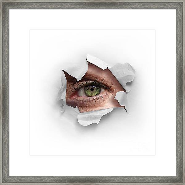 Peek Through A Hole Framed Print