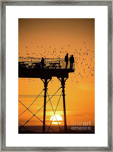 People On The Pier Sunset And Starlings In Aberystwyth Wales Framed Print
