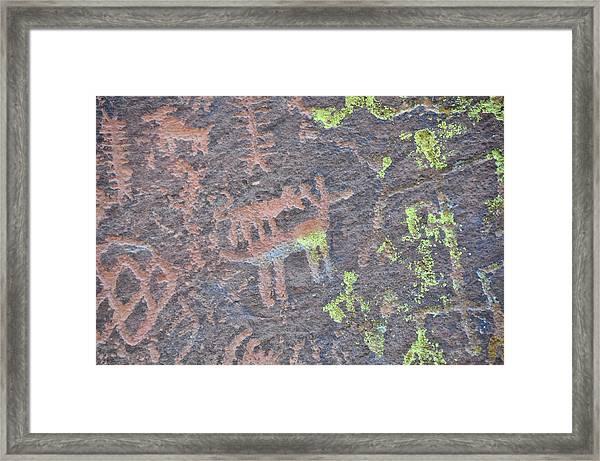 Petroglyph Wolf Attack Framed Print