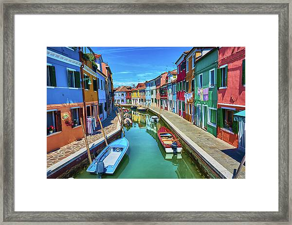 Picturesque Buildings And Boats In Burano Framed Print