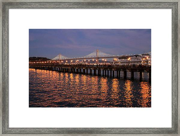 Pier 7 And Bay Bridge Lights At Sunset Framed Print