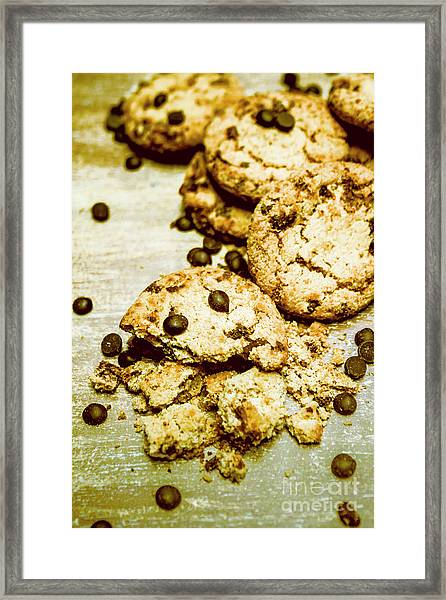 Pile Of Crumbled Chocolate Chip Cookies On Table Framed Print