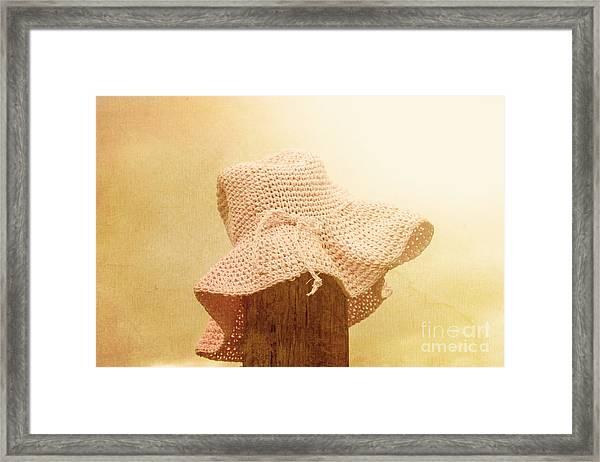 Pink Girls Hat On Farmyard Fence Post Framed Print