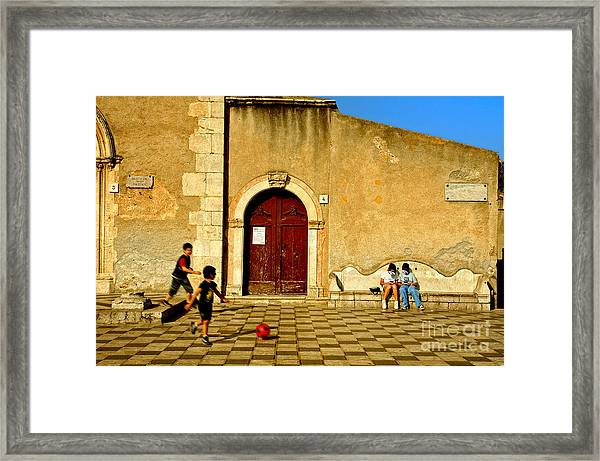 Playing In Taormina Framed Print