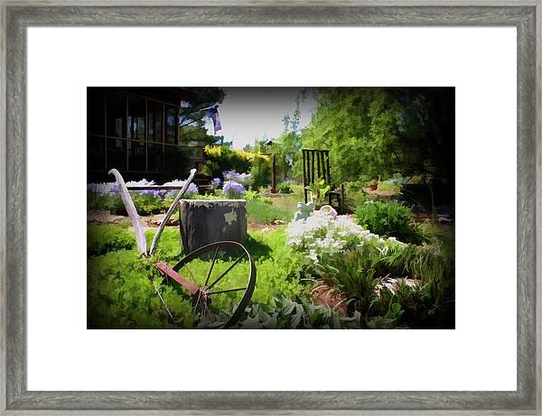 Plow In The Garden Framed Print