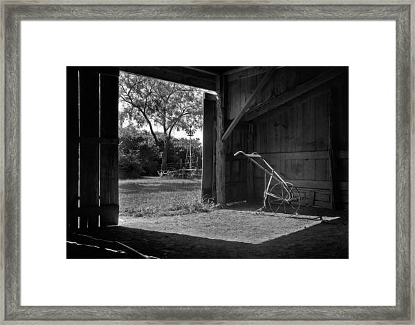 Plow Is In The Barn Framed Print