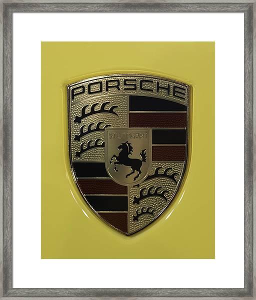 Porsche Emblem On Racing Yellow Framed Print