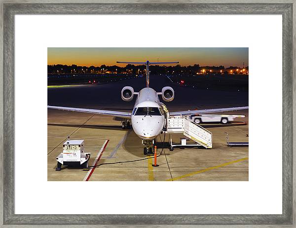 Preparing For Departure Framed Print