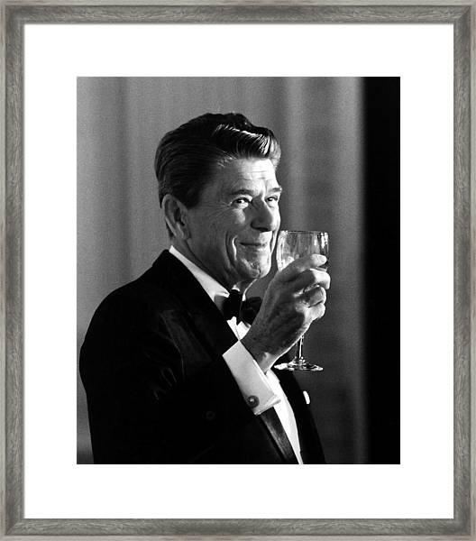 President Reagan Making A Toast Framed Print
