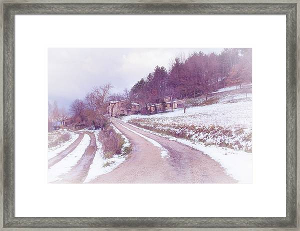 Provencal Village In Snow Framed Print