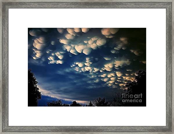 Puffy Storm Clouds Framed Print