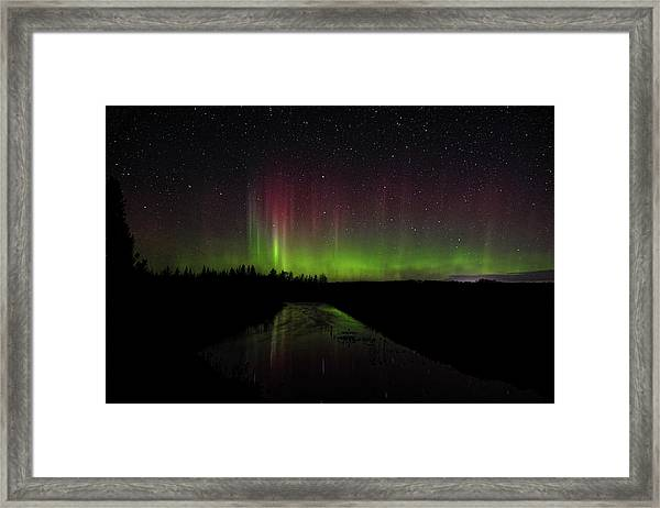 Red And Green Aurora Pillars Framed Print