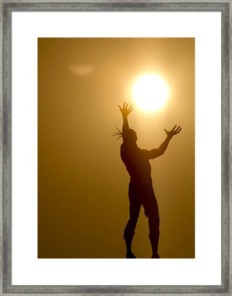 Raising The Sun Framed Print