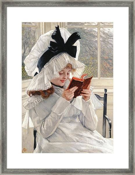 Reading A Book Framed Print