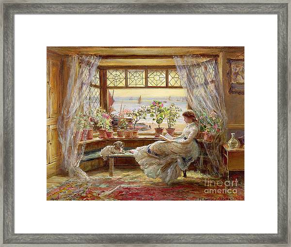 Reading By The Window Framed Print