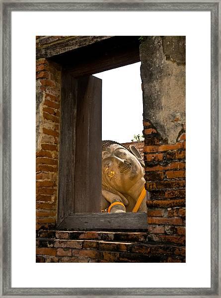 Reclining Buddha View Through A Window Framed Print