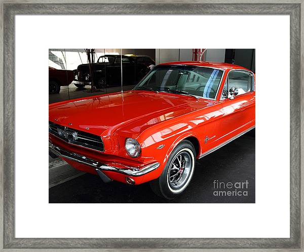 Framed Print featuring the photograph Red 1965 Ford Mustang . Front Angle by Wingsdomain Art and Photography