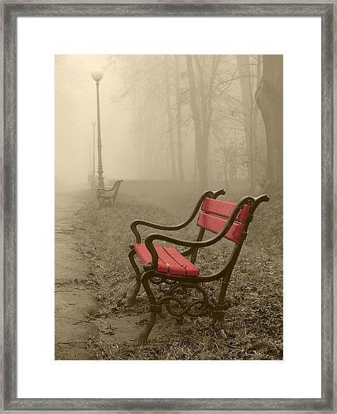 Red Bench In The Fog Framed Print by Jaroslaw Grudzinski