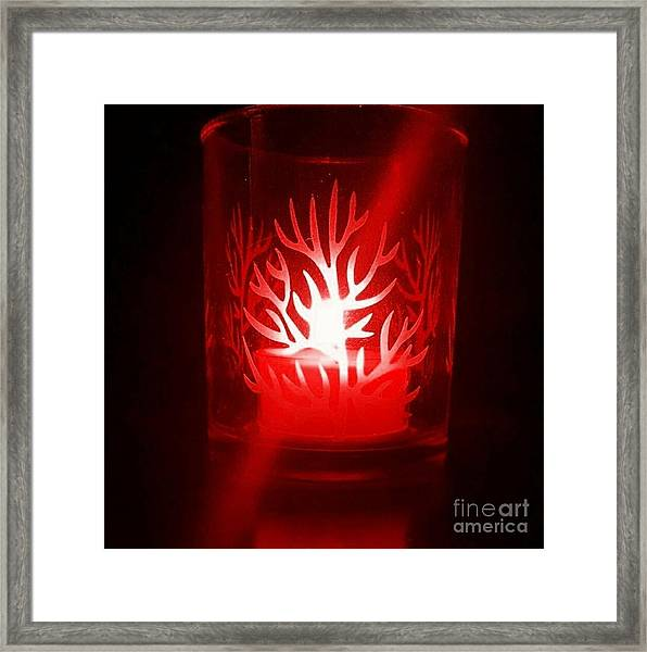 Red Candle Light Framed Print