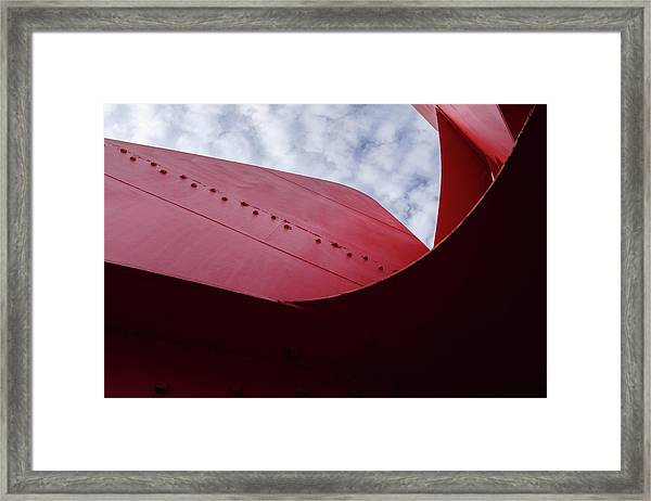 Red Curved Metal Looking Up At The Blue Sky In Grand Rapids Michigan Framed Print