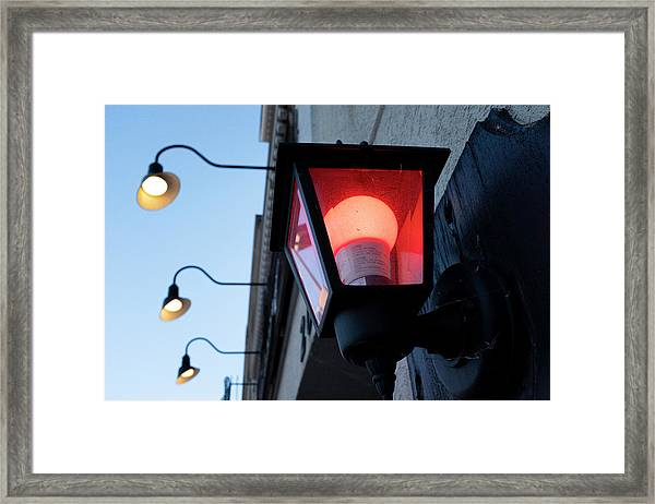 Red Light On The Wall With A Blue Sky And Yellow Bulbs In Holland Michigan Framed Print