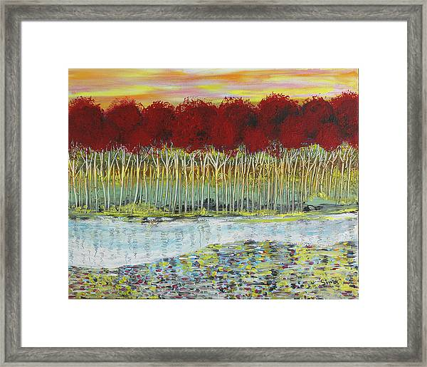 Red Trees At Water Framed Print