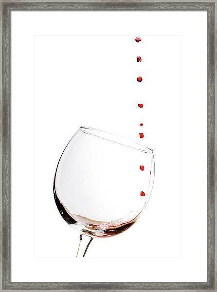 Red Wine Drops Into Wineglass Framed Print