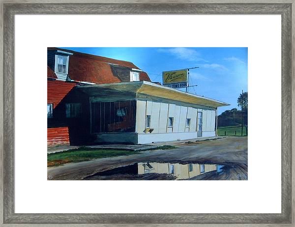 Reflections Of A Diner Framed Print