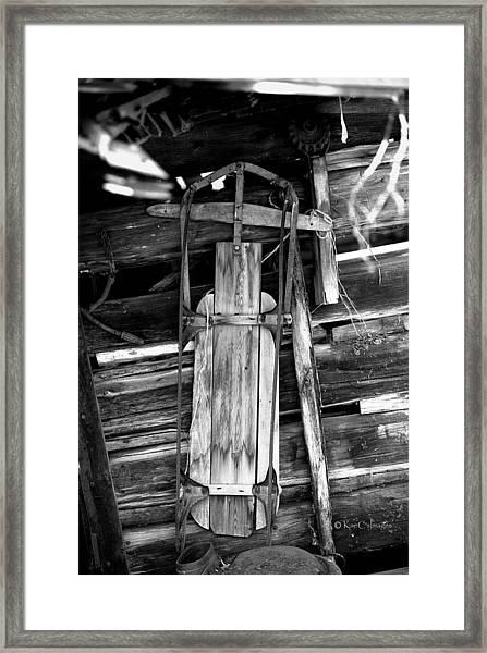 Retired Snow Sled Framed Print
