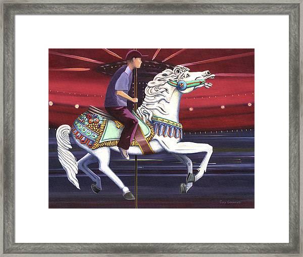 Riding The Carousel Framed Print