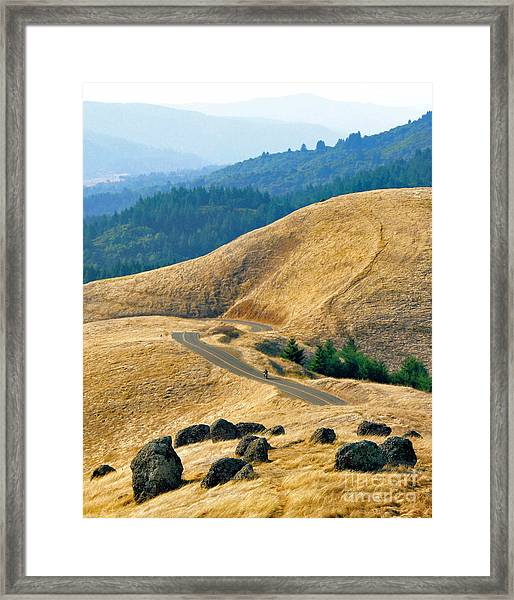 Riding The Mountain Framed Print