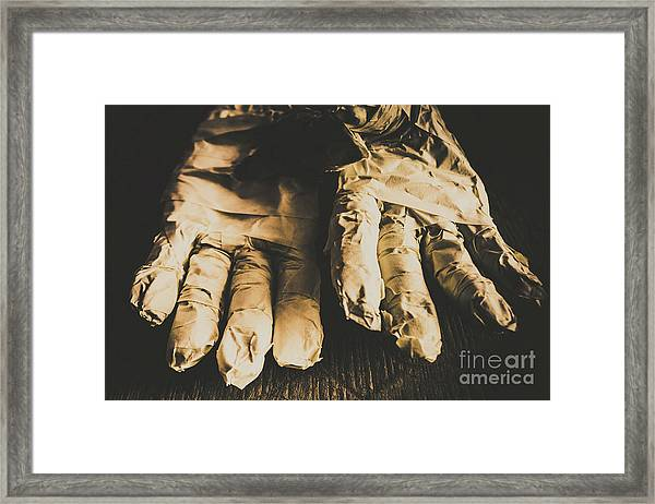 Rising Mummy Hands In Bandage Framed Print